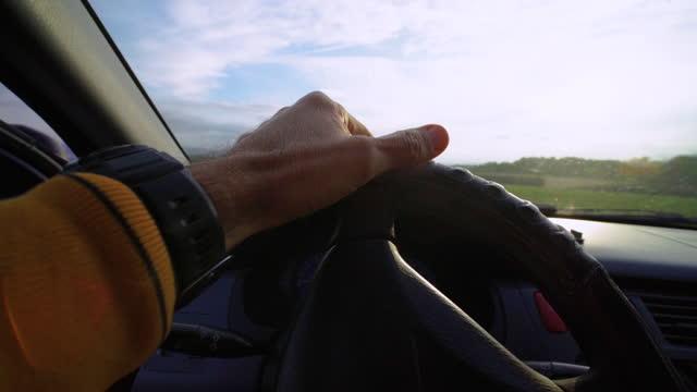 driver pov during covid_19 pandemic. tapping on the steering wheel before turning on the car. waiting for someone or something. active mature man taking his car to go to work. driving with a protective mask on the face. - day in the life stock videos & royalty-free footage