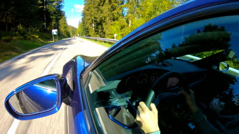 driver enjoying the car ride on a winding mountain road - car interior stock videos & royalty-free footage