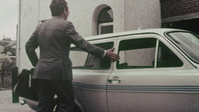 montage driver getting out of his car in improved neighborhood, and houses needing improvement around the country / england, united kingdom - anno 1970 video stock e b–roll