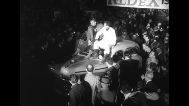 driver jack murray on left and partner bill murray sitting on roof of car at finish line in show grounds at moore park in sydney they have just won... - race distance stock videos & royalty-free footage
