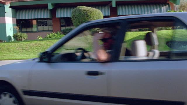 a driver makes an erratic stop on santa monica's ocean park avenue. - ocean avenue stock videos & royalty-free footage