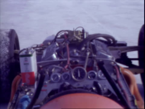 driver mickey thompson seated behind wheel of experimental front engine indy race car / driver ray brock mickey thompson removing car cockpit cover /... - bonneville salt flats stock videos and b-roll footage