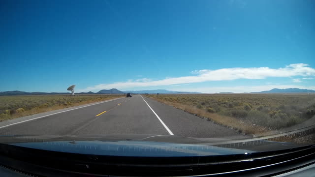Driver pov of driving on rural US highway