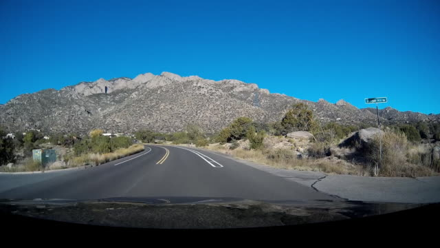 driver pov of driving on rural us highway - フロントガラス点の映像素材/bロール