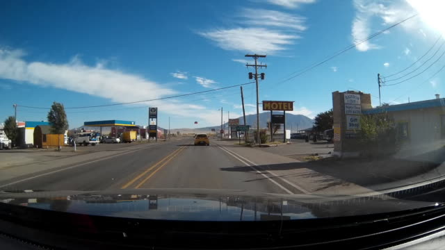 driver pov of driving through a small town in the us - small town stock videos & royalty-free footage