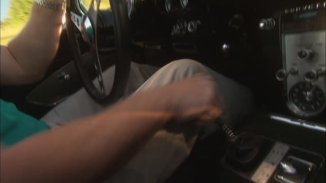 a driver quickly shifts the gears of a classic convertible. - gearshift stock videos & royalty-free footage