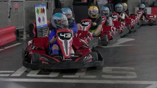 a driver races a go kart on a go-kart track. - go cart stock videos & royalty-free footage