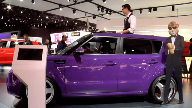 ws driver side profile of dj spinning tunes out of the top of the purple soul / zocu info sign / ws front quarter passenger side view of soul and dj... - curious cumulus productions stock videos and b-roll footage