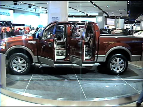ws driver side profile of ford f150 king ranch super crew pickup truck revolving on turntable / cu king ranch fender emblem / ms castano leather... - ford truck stock videos and b-roll footage