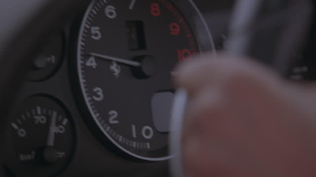 a driver steering a ferrari. - speedometer stock videos & royalty-free footage