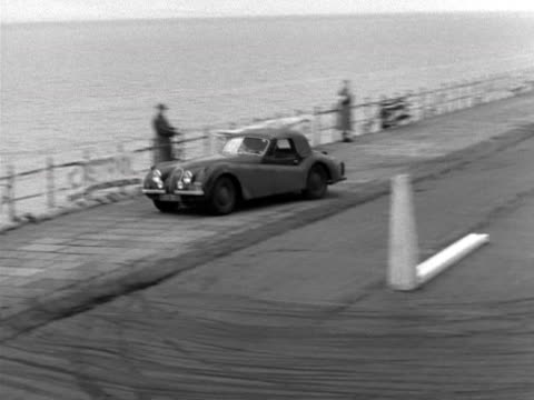 a driver takes part in a driving skills test on the blackpool seafront as part of the rac british international rally - driving test stock videos and b-roll footage