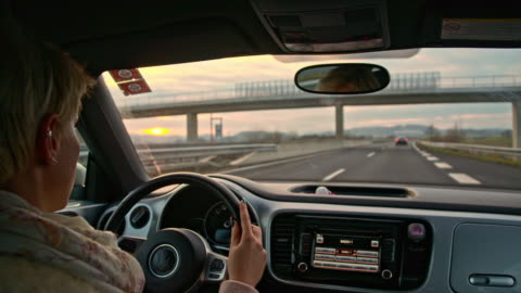 slo mo driver taking a freeway exit - driver stock videos & royalty-free footage