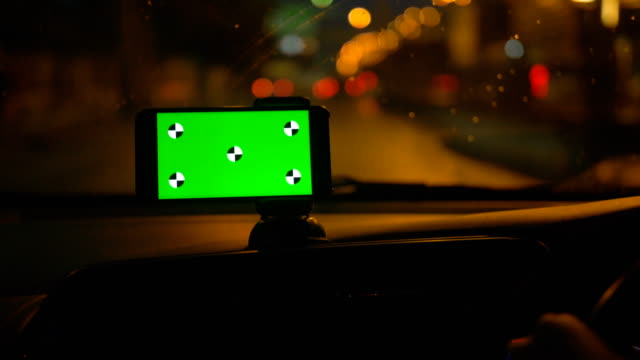 driver using smart phone with green screen in a car - wap stock videos & royalty-free footage