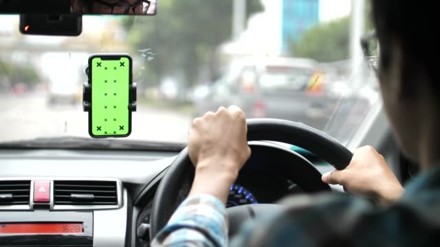 driver using smart phone with green screen in a car - car chroma key stock videos & royalty-free footage