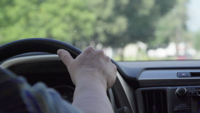 DRIVING, Driver with ONE HAND ON steering WHEEL
