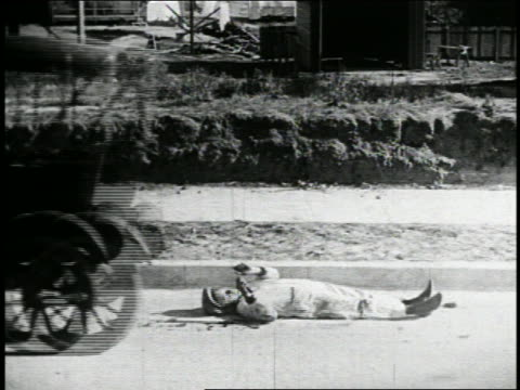 b/w 1925 driverless car taking off to reveal mechanic underneath who stands up + runs / feature - vintage car stock videos and b-roll footage
