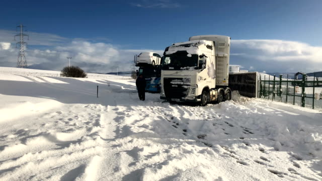 drivers are urged to stay of the roads as motorist spend the night stranded on the m74 motorway on january 17 2018 in crawford scotland mountain... - dumfries and galloway stock videos & royalty-free footage
