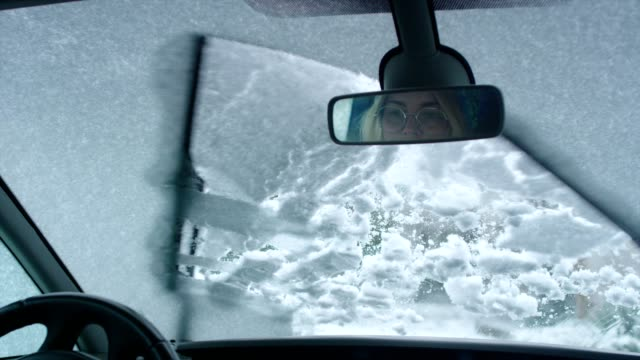 driver's pov. car wipers cleaning snow on window - danger stock videos & royalty-free footage