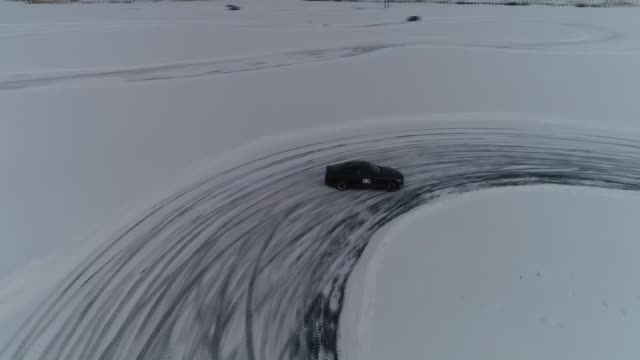 drivers enjoy driving training on a frozen lake as the cold weather covered it with snow in turkey's northeastern kars province on friday 2020... - kars stock videos & royalty-free footage