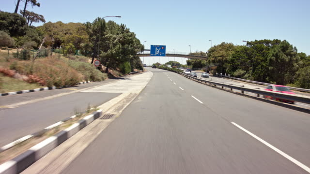 drivers pov - part-10: city highway in suburb cape town - other cars in frame - cape town stock videos & royalty-free footage