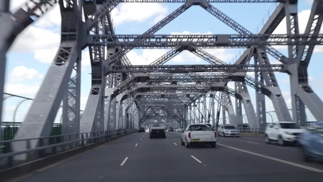 drivers pov driving across 'story bridge' brisbane camera looks up to the structure of the bridge and back to the traffic on the road - car point of view stock videos & royalty-free footage