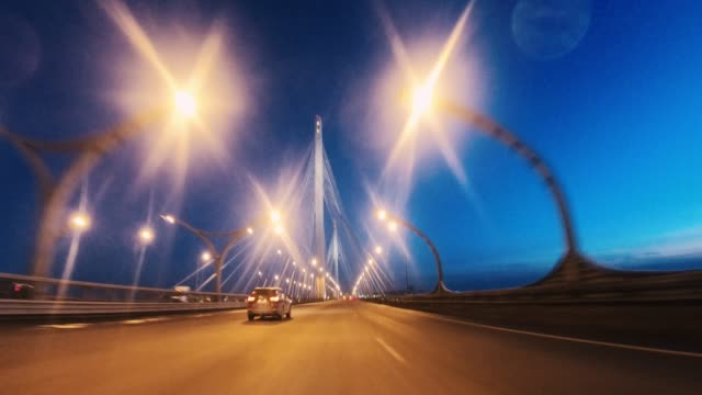 driver's pov through  metropolitan highway junctions. - street light stock videos & royalty-free footage