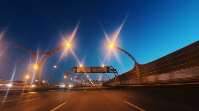 driver's pov through metropolitan highway junctions. - fanale anteriore video stock e b–roll