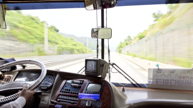 driver's seat of a bus running - bus driver stock videos & royalty-free footage