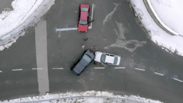 aerial drivers stepping out of the cars at the scene of a car accident - incidente automobilistico video stock e b–roll