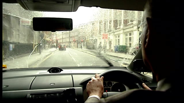 drivers who don't use screenwash at greater risk of legionnaires disease england london ext close shot screenwash and wiper blades cleaning car... - close up squirt stock-videos und b-roll-filmmaterial