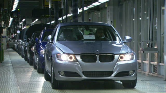 A BMW drives off the assembly line in an automobile factory.