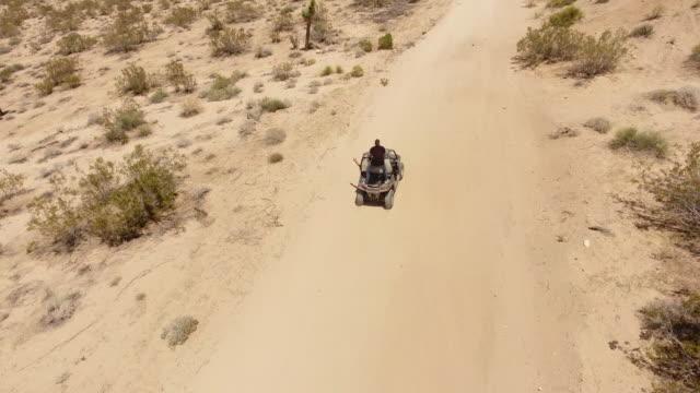 driving 4x4 in mojave desert - quadbike stock videos & royalty-free footage