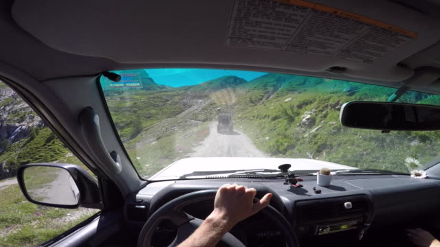 pov driving 4x4 vehicle off road up mountain pass - wing mirror stock videos and b-roll footage