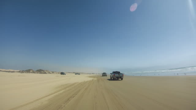pov driving a 4wd car on the beach of oceano - dune buggy stock videos and b-roll footage