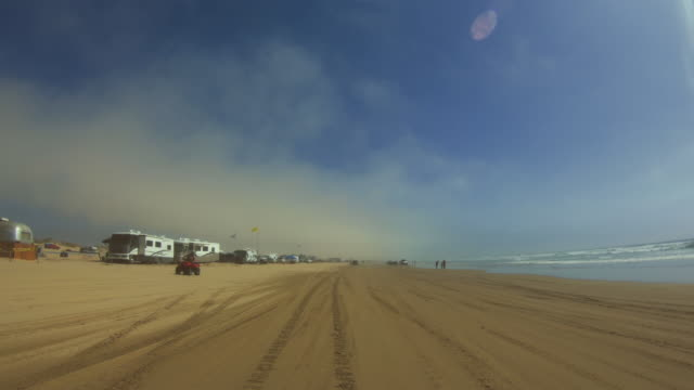pov driving a 4wd car on the beach of oceano - quadbike stock videos & royalty-free footage