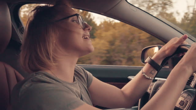 driving a car and having fun - singing stock videos & royalty-free footage