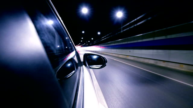 driving a car at night trough tunnel - generic location stock videos & royalty-free footage