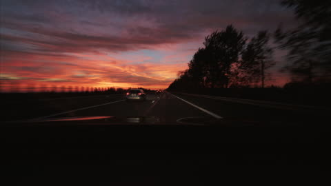 driving a car at sunset. - real time stock videos & royalty-free footage