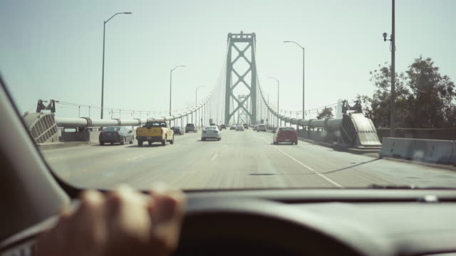 Driving a car POV: bridge to San Francisco
