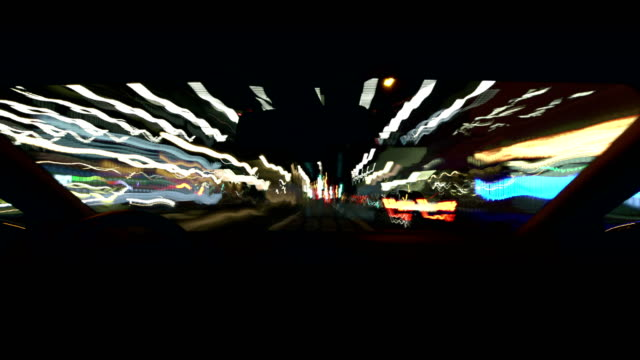 POV Driving a car in a city at night