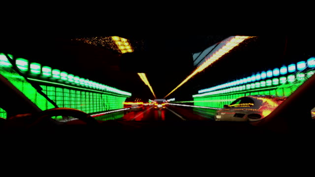 pov driving a car in a tunnel - lenkrad stock-videos und b-roll-filmmaterial
