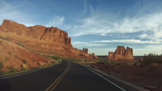 pov driving a car in arches national park - cultura americana video stock e b–roll