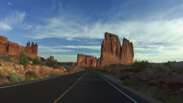 pov driving a car in arches national park - mountain range stock videos & royalty-free footage