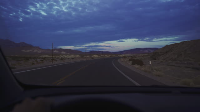 pov driving a car in death valley highways - zabriskie point video stock e b–roll