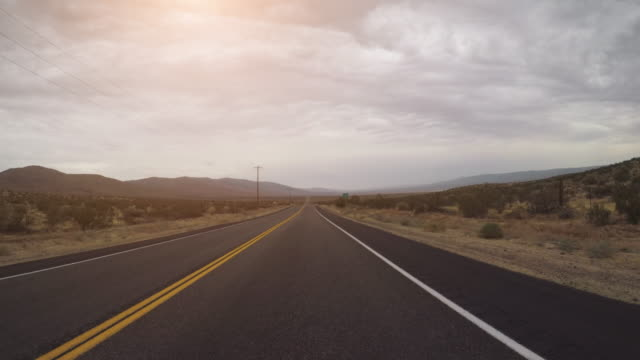 pov driving a car in death valley highways - autostrada video stock e b–roll
