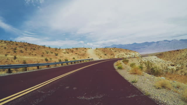 pov driving a car in death valley highways - zabriskie point stock videos & royalty-free footage