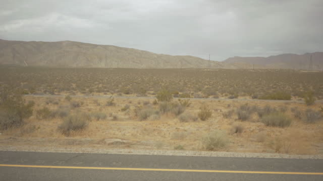 driving a car in death valley scenic roads pov - side view stock videos & royalty-free footage