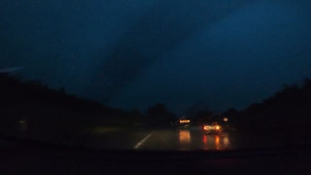 driving a car in heavy rain, the perspective of the driver and co-driver - danger stock videos & royalty-free footage
