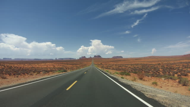 pov driving a car in monument valley - monument valley stock videos & royalty-free footage