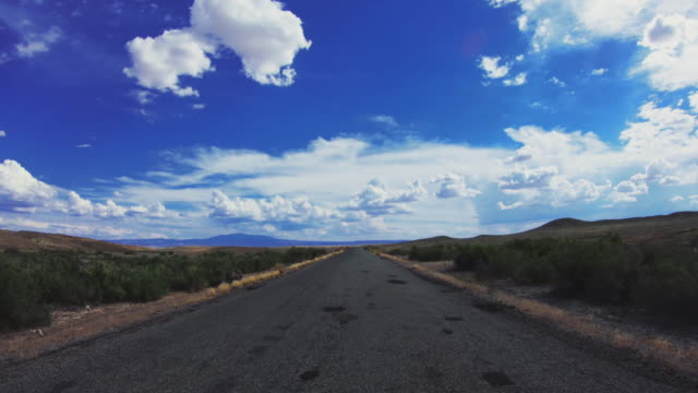 pov driving a car in scenic roads - digital camcorder stock videos & royalty-free footage